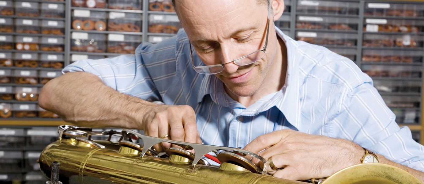 Man repairing a saxaphone